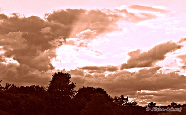 sunlight piercing cloud